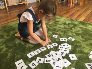 Girl learning the alphabet as a young child.