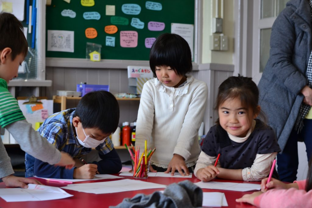 Kids learning while studying in English during the weekend program.